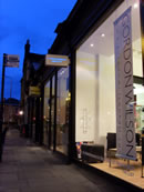 Gordon Wilson Hairdressing shop front at night
