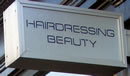 Street sign for Gordon Wilson Hairdressing and Beauty